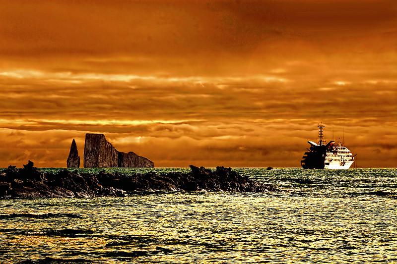 Kiker rocks and a cruise ship anchored by Espanola Island of the Galapagos Island archipelago, Ecuador.