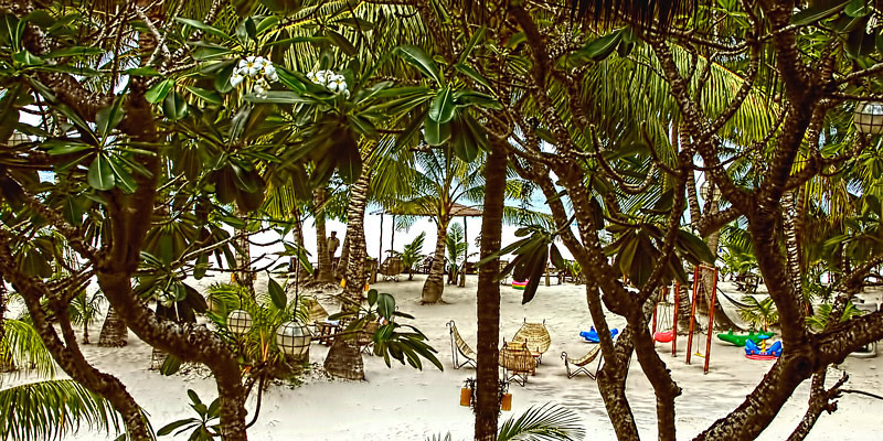 View from our second floor balcony, with the white sand beach beyond the trees. Photo taken in Boracay Island, Aklan Province, Philippines.