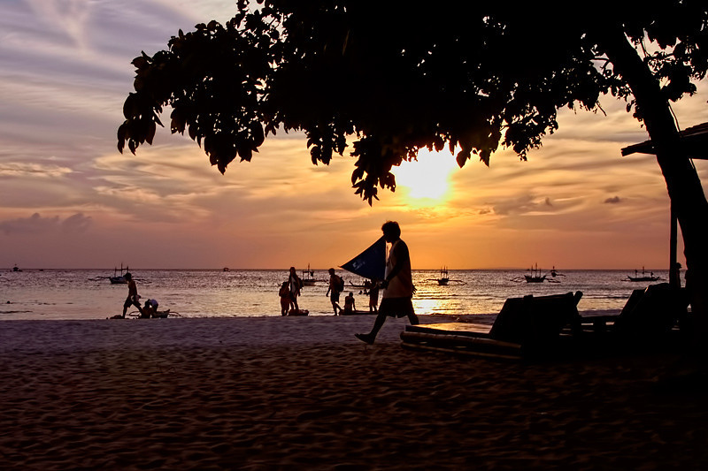 Sunset at white sand beach, Boracay Island, Philippines.