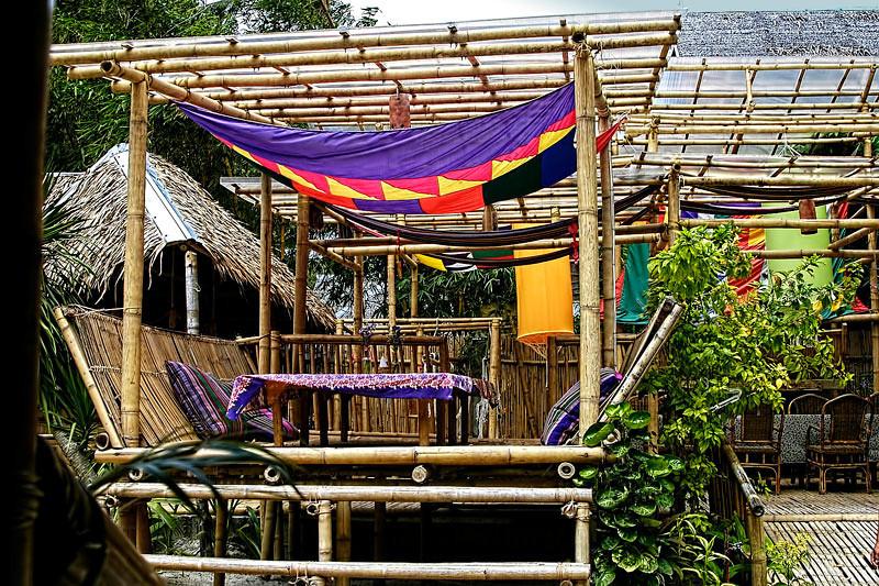 Open air dining cabanas overlooking white sand beach of Boracay Island.