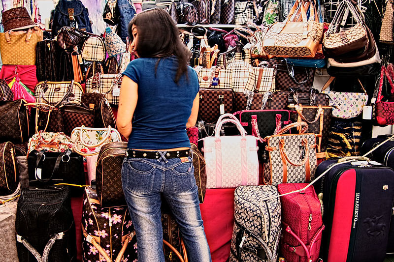 A pretty shopper got conscious when I clicked my camera shutter. Spotted at Tutuban Mall, Manila, Philippines.