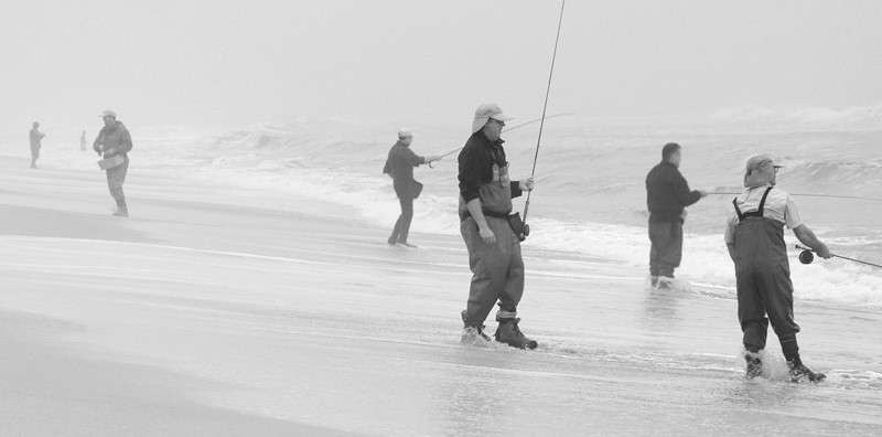 Fishing in the early morning fog at Sunset Beach, an unincorporated beach front in Orange County, California, USA.