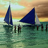 Sunset at White Sands Beach, Boracay Island, Aklan Province, Philippines. Those people are boarding the boats to go home to the main Island of Aklan.