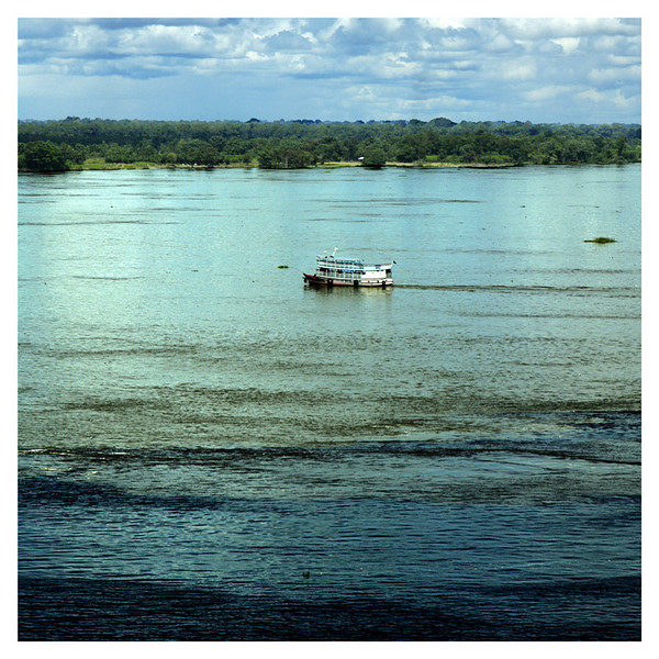 The meeting of the chocolat colored waters and clean blue waters at Amazon River, Brazil.