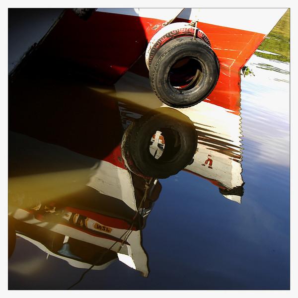 Boat reflection at Rio Negro, Manaus, Brazil.