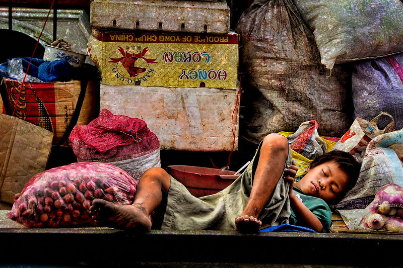 "This is the second of two of the photographs in my pictorial book ""DIVISORIA"". A documentation of the poverty and neglect of children in the city of Manila. You may click on the link to preview my book <a href=""http://www.blurb.com/bookstore/detail/852303""><b>DIVISORIA<b></a>"