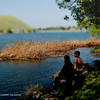 Photo taken at Contra Loma Regional Park in Antioch, California. Two boys fishing and quietly talking to each other.