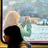 She is the blonde young woman who stayed outside in the cold wind and fog to be able to take pictures as we cruise San Francisco Bay, California.