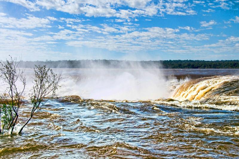 At the edge of Iguazu Falls, Argentina.
