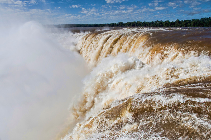"At the edge of Iguazu Falls, Argentina. This part of the falls is called ""The Devils Throat""."