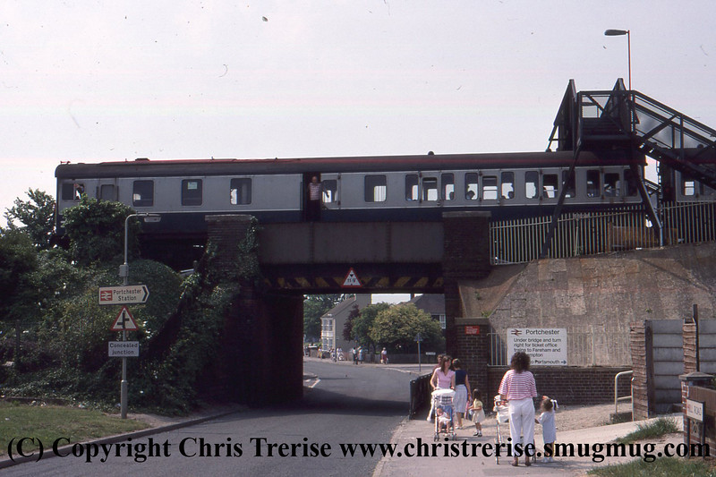 Class 205 3 Car Thumper DEMU number 205 0xx is seen at Portchester.<br /> 1989