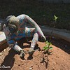 Figurine Tending Garden