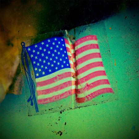 American flag decal on old door