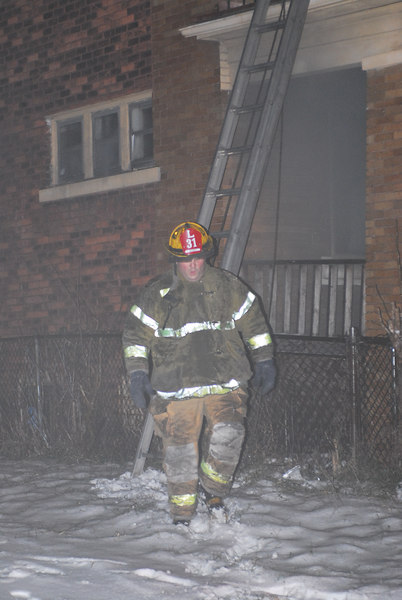 Detroit, MI Ladder 31 member at the scene of a Box Alarm Continental and East Jefferson. Photo By: Adam Alberti