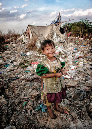 A young girl, a refugee from Burma, by her home in a Thailand city dump.