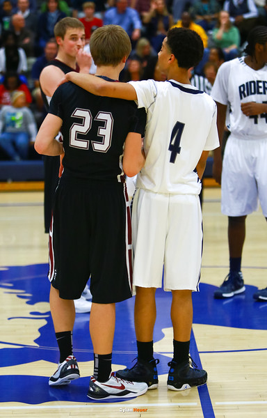 Roosevelt junior guard Jordan Johnson, Dowling senior guard Jack Green