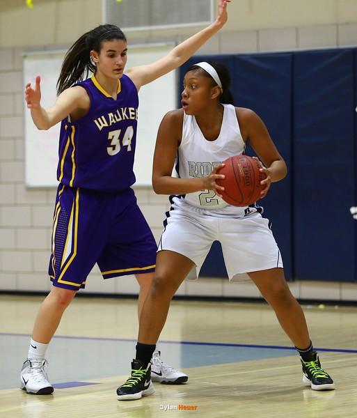 Roosevelt junior guard Maleika Carter, Waukee sophomore forward Reilly Jacobson
