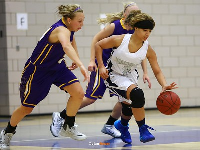 Roosevelt junior guard Maleika Carter, Waukee junior guard Anna Kollmorgen