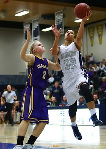 Roosevelt junior forward Julanie Carter, Waukee senior guard Taylor Wingert