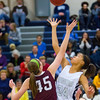 Roosevelt junior center Meredith Burkhall, Dowling junior forward Audrey Faber