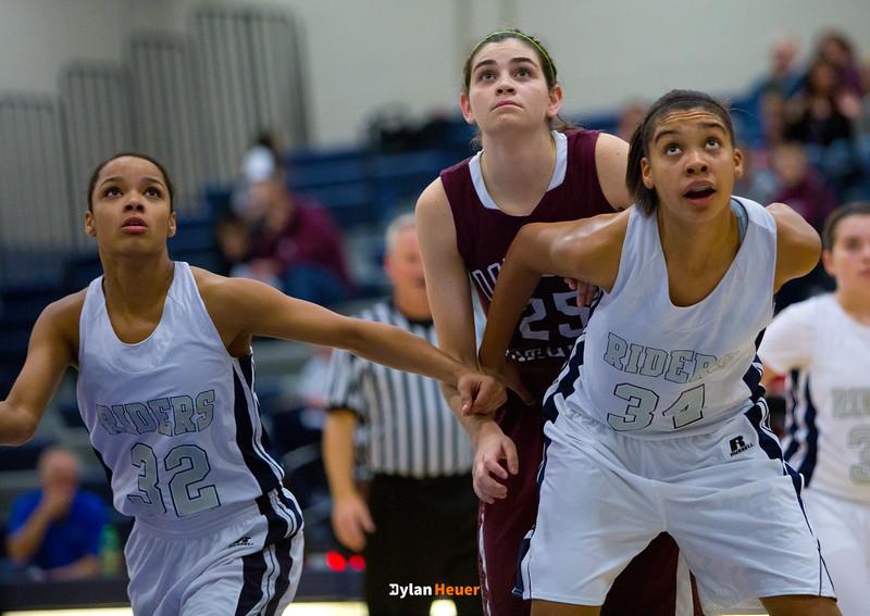 Dowling senior center Luci Sarcone, Roosevelt junior forward Julanie Carter, Roosevelt junior center Meredith Burkhall