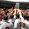 Pleasantville celebrates their second-place finish at the Class 1A State Championship at Principal Park in Des Moines, Iowa on Saturday, August 1, 2015. (Photo by Dylan Heuer/Iowa Cubs)