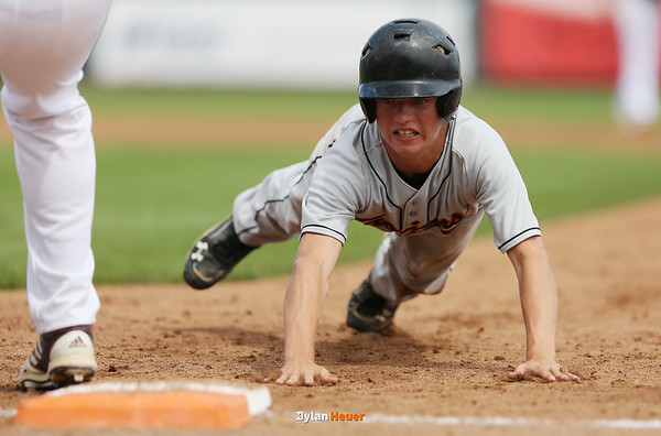 Pleasantville's Cassin Garr dives back into first base during the third inning in the Class 1A State Championship at Principal Park in Des Moines, Iowa on Saturday, August 1, 2015. (Photo by Dylan Heuer/Iowa Cubs)