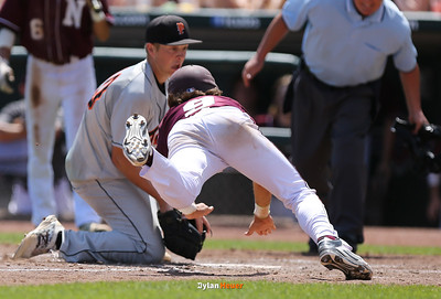 Newman's Josh Fitzgerald scores past Pleasantville's Zeb Adreon on a wild pitch during the fifth inning in the Class 1A State Championship at Principal Park in Des Moines, Iowa on Saturday, August 1, 2015. (Photo by Dylan Heuer/Iowa Cubs)
