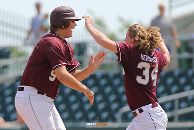 Bryce Ball and Joey Verstegen celebrate Newman's 10-0 victory over Pleasantville at the Class 1A State Championship at Principal Park in Des Moines, Iowa on Saturday, August 1, 2015. (Photo by Dylan Heuer/Iowa Cubs)