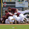 Players dogpile each other after Newman defeated Pleasantville, 10-0, at the Class 1A State Championship at Principal Park in Des Moines, Iowa on Saturday, August 1, 2015. (Photo by Dylan Heuer/Iowa Cubs)
