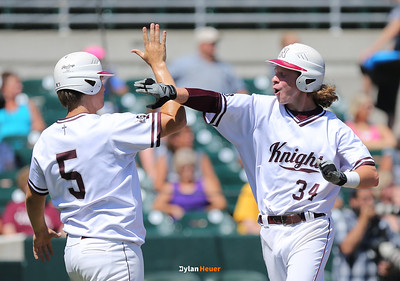 Newman's Bryce Ball (#5) and Joey Verstegan celebrate after they scored a pair of runs during the third inning in a Class 1A Semifinals game at Principal Park in Des Moines, Iowa on Thursday, July 30, 2015. (Photo by Dylan Heuer/Iowa Cubs)