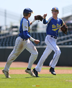 MSTM shortstop Trevor Dooley and second baseman Spencer Hoyka celebrate after getting out of the fourth inning in a Class 1A Semifinals game at Principal Park in Des Moines, Iowa on Thursday, July 30, 2015. (Photo by Dylan Heuer/Iowa Cubs)