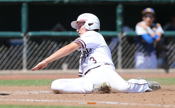 Newman's Peyton Scott scores on a wild pitch during the fifth inning in a Class 1A Semifinals game at Principal Park in Des Moines, Iowa on Thursday, July 30, 2015. (Photo by Dylan Heuer/Iowa Cubs)