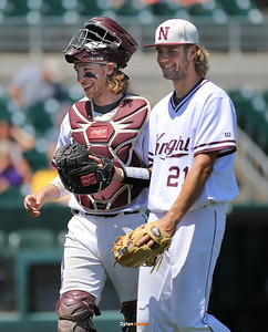 Newman catcher Parker Dondlinger and Kaden Walde celebrate after finishing the sixth inning in a Class 1A Semifinals game at Principal Park in Des Moines, Iowa on Thursday, July 30, 2015. (Photo by Dylan Heuer/Iowa Cubs)