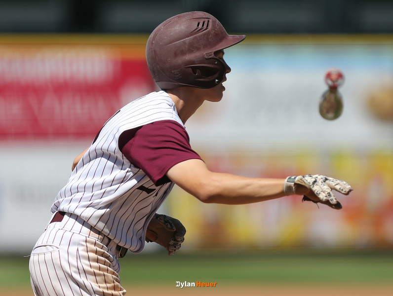 North Linn's Jake Hilmer tosses his bat after getting a walk during the fifth inning in a Class 1A Semifinals game at Principal Park in Des Moines, Iowa on Thursday, July 30, 2015. (Photo by Dylan Heuer/Iowa Cubs)