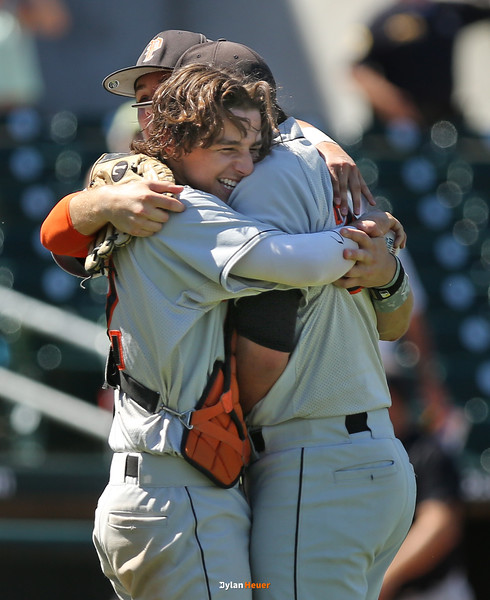 Nash Rechkemmer and Josh Luna celebrate after Pleasantville defeated North Linn, 6-3, in a Class 1A Semifinals game at Principal Park in Des Moines, Iowa on Thursday, July 30, 2015. (Photo by Dylan Heuer/Iowa Cubs)