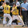 Clear Lake's Mitch Keeran (#13) celebrates with Zach Lester after they scored runs during the third inning in the Class 2A State Championship at Principal Park in Des Moines, Iowa on Saturday, August 1, 2015. (Photo by Dylan Heuer/Iowa Cubs)