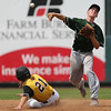 Columbus shortstop Henry Walters completes a double play over Clear Lake's Parker Tresdell during the fourth inning in the Class 2A State Championship at Principal Park in Des Moines, Iowa on Saturday, August 1, 2015. (Photo by Dylan Heuer/Iowa Cubs)