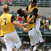 Brock Adams and catcher Randy Yates celebrate Clear Lake's 11-1 victory over Columbus after the Class 2A State Championship at Principal Park in Des Moines, Iowa on Saturday, August 1, 2015. (Photo by Dylan Heuer/Iowa Cubs)