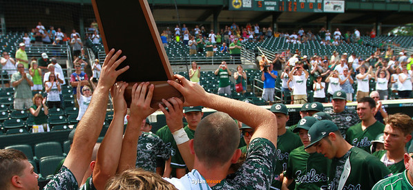 Columbus players show their second-place trophy to their fans after the Class 2A State Championship at Principal Park in Des Moines, Iowa on Saturday, August 1, 2015. (Photo by Dylan Heuer/Iowa Cubs)