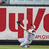 Davis County right fielder Mathew Hopkins makes a sliding catch during the sixth inning in a Class 2A Quarterfinals game at Principal Park in Des Moines, Iowa on Tuesday, July 28, 2015. (Photo by Dylan Heuer/Iowa Cubs)