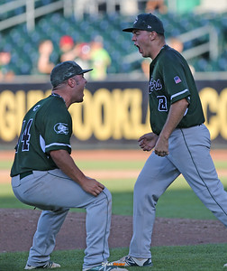 Closer Luke Farley and Henry Dropps (#14) celebrate Columbus' 5-3 victory over Cascade after a Class 2A Semifinals game at Principal Park in Des Moines, Iowa on Thursday, July 30, 2015. (Photo by Dylan Heuer/Iowa Cubs)
