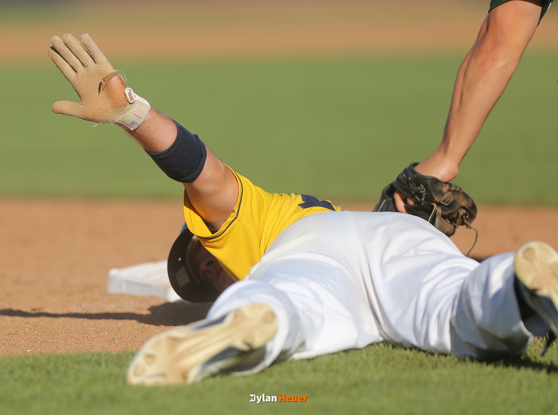 Cascade's Luke Recker calls for time after safely diving back into third base during the fourth inning in a Class 2A Semifinals game at Principal Park in Des Moines, Iowa on Thursday, July 30, 2015. (Photo by Dylan Heuer/Iowa Cubs)