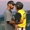 Clear Lake's coach Seth Thompson talks with Mitch Keeran during the third inning in a Class 2A Semifinals game at Principal Park in Des Moines, Iowa on Thursday, July 30, 2015. (Photo by Dylan Heuer/Iowa Cubs)