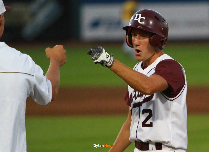 Davis County's Jacob Jones celebrates after hitting a single during the second inning in a Class 2A Semifinals game at Principal Park in Des Moines, Iowa on Thursday, July 30, 2015. (Photo by Dylan Heuer/Iowa Cubs)