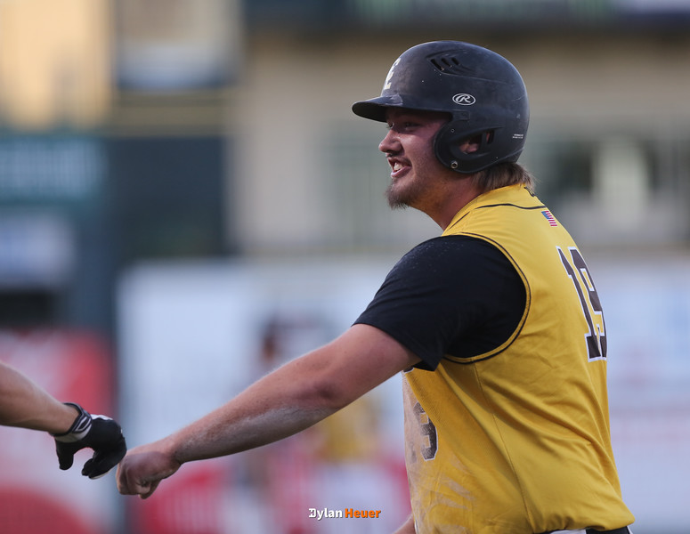 Clear Lake's Ethan MeHenry celebrates after scoring a run during the first inning in a Class 2A Semifinals game at Principal Park in Des Moines, Iowa on Thursday, July 30, 2015. (Photo by Dylan Heuer/Iowa Cubs)