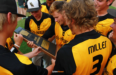 WSR's Alex Robson (center) and teammate embrace the state title trophy after the Class 3A State Championship at Principal Park in Des Moines, Iowa on Saturday, August 1, 2015. (Photo by Dylan Heuer/Iowa Cubs)