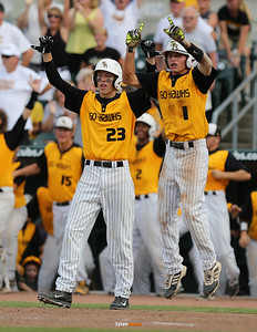 Cole Havlovic (#23) and Dalton Graven celebrate WSR's 11-1 victory over Harlan after the Class 3A State Championship at Principal Park in Des Moines, Iowa on Saturday, August 1, 2015. (Photo by Dylan Heuer/Iowa Cubs)