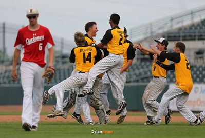 WSR celebrates their 11-1, walk-off victory as Harlan first baseman Kyle Juhl walks off the field after the Class 3A State Championship at Principal Park in Des Moines, Iowa on Saturday, August 1, 2015. (Photo by Dylan Heuer/Iowa Cubs)
