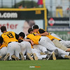 WSR celebrates their 11-1 victory over Harlan after the Class 3A State Championship at Principal Park in Des Moines, Iowa on Saturday, August 1, 2015. (Photo by Dylan Heuer/Iowa Cubs)